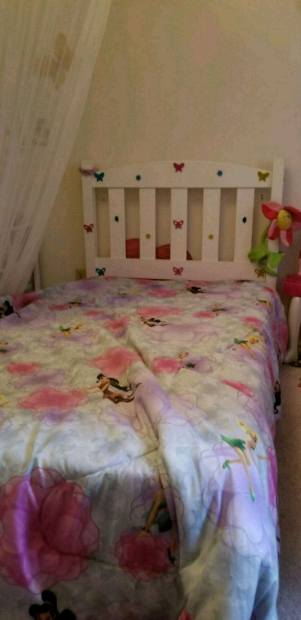 white and pink floral bed mattress