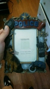 gray and brown police embossed photo frame Thibodaux, 70301