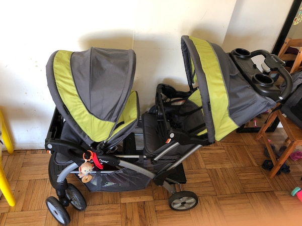 Baby's black and green tandem stroller