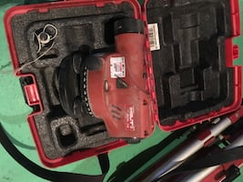 Red and black milwaukee cordless power drill