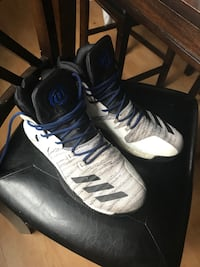 Pair of white-and-black addidas basketball shoes