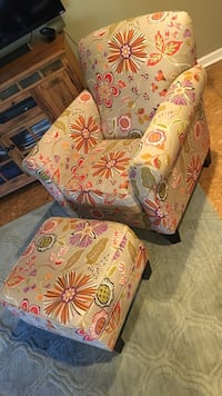 and green floral fabric sofa chair