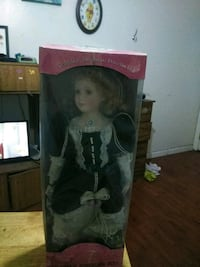 porcelain doll in white and black dress Rialto, 92377