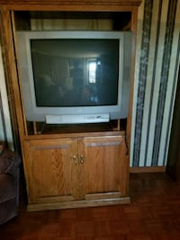 gray CRT television with brown wooden TV hutch Cedar Hill, 37032