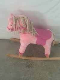 pink and white horse plush toy