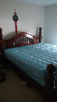 black wooden bed frame with blue mattress Mount Airy, 21771