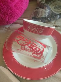 red and white ceramic Coca-Cola bowl with plate and drinking glass