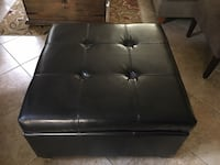 Black faux leather tufted ottoman chair