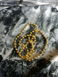 gold-colored and black beaded bracelet 218 mi