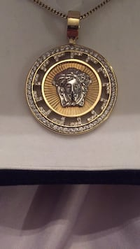 Versace 10KT Gold pendant with 10K gold chain. Burnaby, V5H