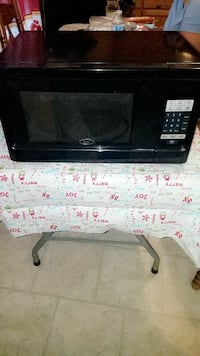 black Oster microwave oven