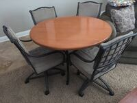 round brown wooden table with four chairs 2221 mi