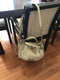 Beautiful Coach purse in pearlized off-white leather.Two-tone hardware Leesburg, 20176
