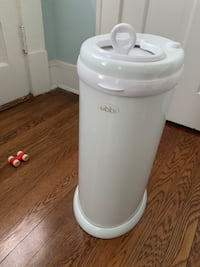 Ubbi diaper genie for sale. In brand new condition. In light grey so it blends it nicely in any type of room. No need for special bags.  Alexandria, 22305