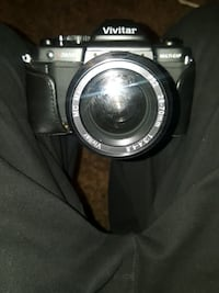 black and gray Vivitar DSLR camera