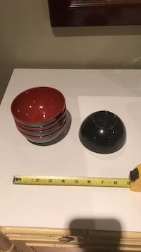 several black-and-red ceramic rice bowls