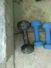 three blue and black metal dumbbells
