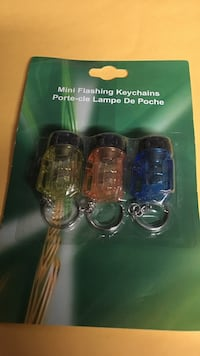 three assorted colors of mini flashing key chains pack