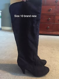 pair of black suede knee-high boots London, N5X 0G1