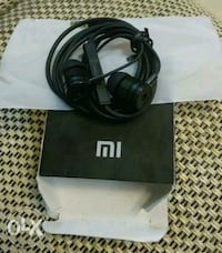 black and gray corded headphones with box Chennai
