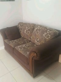 brown and black floral fabric sofa chair Vancouver, V5K 2H8