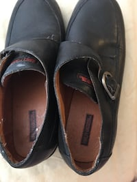 pair of black leather shoes Vallejo