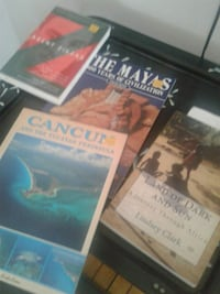four assorted-title book