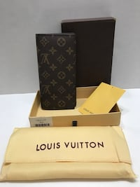 Unisex long wallet brand new price is firm pick up only  Edmonton, T6B