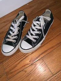 pair of black Converse All Star high top sneakers
