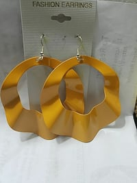 pair of silver-colored hook-earrings with round yellow pendant