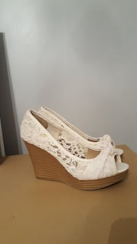 pair of white peep toe wedge sandals Surrey