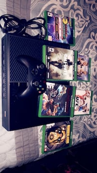 black Xbox One console with controller and game cases Mantachie, 38855