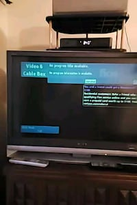black flat screen TV with remote Ashburn, 20147