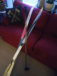 Brand New Fisher Country Crown skis with Nordic swix00 poles.