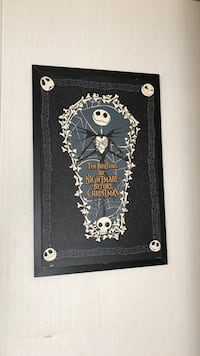 Tim Burtons the Nightmare Before Christmas with black wooden frame