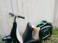 black and green motor scooter Summerfield, 34491