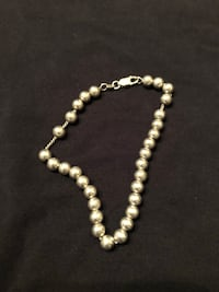 white and silver beaded necklace