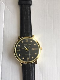 round gold-colored analog watch with black leather strap Montréal, H4K 1E5
