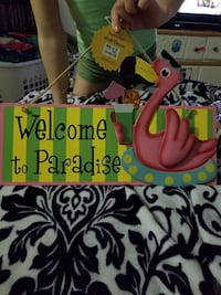 Welcome to Paradise signage