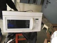 white General Electric microwave oven Laval, H7W 1S3