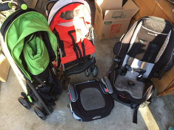 baby's black and green travel system