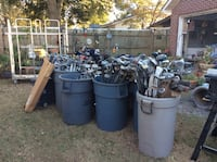 collection of golf clubs yard sale