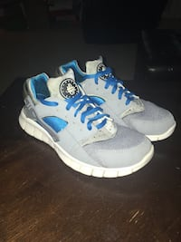 pair of white-and-blue Nike running shoes Augusta, 30907