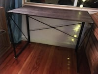 Rectangular black and brown wooden desk 931 mi