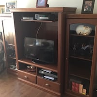 brown wooden TV hutch with flat screen television Varennes