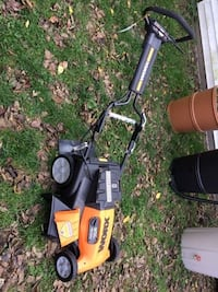 Worx 36 volt cordless electric lawnmower with rear bagger not shown, like new. Morris
