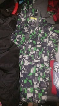 green and black camouflage print polo shirt 3120 km