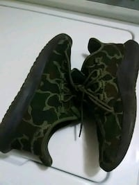 pair of black-and-green camouflage boots