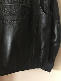 "Authentic harley davidson jacket with zippered vents in the back. logo on front and back. it's a large .  to uses as a reference i am 5'11"" 185 and it's a lil loose. worn maybe 8,9 times Hewitt, 76643"