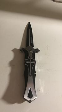 black folding knife with silver handle